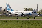SprintAir Saab 340 aircraft running on the runway