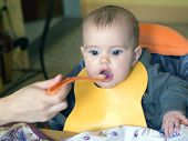 Baby Girl Opens His Mouth To Eat  Food From   Mother