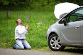 Funny Driver Praying A Broken Car By The Road