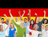 Multi-Ethnic People Arms Raised and German Flag Background
