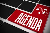 The word agenda and idea and innovation graphic on black keyboard with red key
