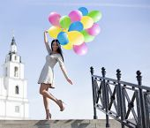 Woman With Balloons - Stock Image