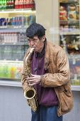 New York City -october 10: Mature Asian Man At Times Square Playing The Saxophone, October 10,2013