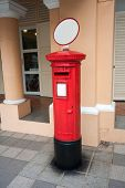 Famous classic red  old postbox on the street of the Singapore