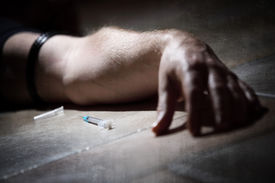 picture of crack addiction  - Drug addict with syringe lying down on the floor concept for self harm - JPG