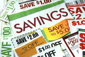 stock photo of save money  - Cut up some coupons to save money - JPG