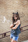Bad Sexy Woman With Leather Cat Ears Showing Fingers