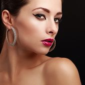 Sexy Female Model Face. Closeup. Bright Makeup. Pink Lips And Eyeliner