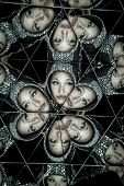 Posing, woman with helmet in a kaleidoscope of mirrors