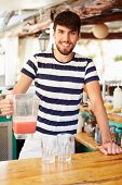 Portrait Of Man In Restaurant Making Fruit Smoothies