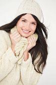 Studio Portrait Of Woman Wearing Warm Winter Clothes