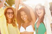 Group Of Female Friends Having Party On Beach Together