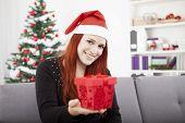 Girl Gives Christmas Present To Someone