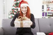 Girl Is Happy Giving Christmas Present