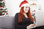 Girl With Santa Hat Is Shopping Online