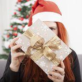 Girl Is Hide Behind Christmas Present