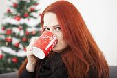 Woman Is Drinking Coffee Or Tea On Christmas