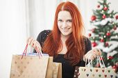 Young Happy Girl With Christmas Bags