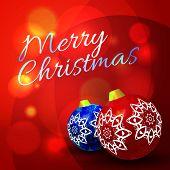 Christmas balls on abstract bokeh background