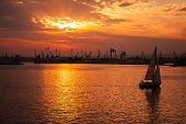 Yacht Goes In Varna Harbor At The Sunset