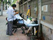 Vietnamese Open Air Barber Shop On Pavement