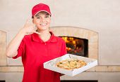 picture of take out pizza  - Delivery woman is holding the pizza box in hand and asking you to order pizza for delivery - JPG