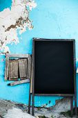 Empty old menuboard on a street