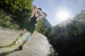 Runner Warming Arms With Sun Flare