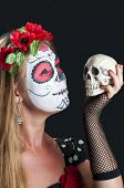 Girl with Calavera Mexicana makeup mask