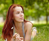 Beautiful Young Woman lying in Meadow