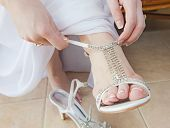 Bride Putting On Wedding Sandals