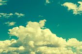 Turquoise Blue Cloudy Sky Background. Vintage Style