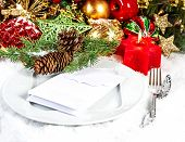 Christmas Table Place Setting With Red And Gold Decorations