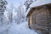 Beautiful Wooden Hut In A Snowy Forest