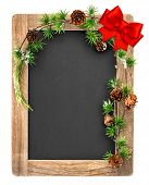 Chalkboard With Christmas Decoration And Red Ribbon Bow