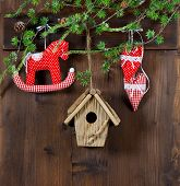 Christmas Decoration. Rocking Horse And Red Hearts On Wooden Background