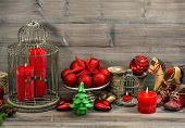 Christmas Decorations With Red Candles, Baubles, Stars And Rocking Horse