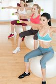 Women Training With Dumbbells.
