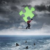 Businessman Carrying Puzzle Above The Sea
