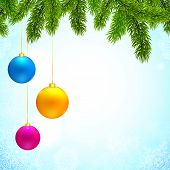 Christmas background with fir tree branches and colorful hanging balls
