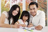 Happy Parents Help Their Child Studying