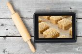 On-line bakery concept with a touch screen tablet and rolling pin