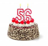 Birthday cake with burning candle number 56