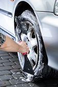 Hand Cleaning Car Wheel