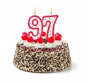 Birthday cake with burning candle number 97