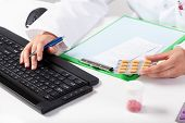 Pharmacist During Work In Pharmacy