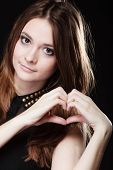 Teen Girl Doing Heart Shape Love Symbol With Hands