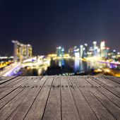 wooden board with  blurred cityscape