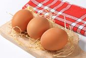 eggs on wooden cutting board