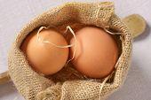 detail of eggs in burlap sack